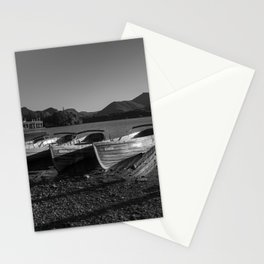 a black and white image of rowing boats moored at derwentwater Stationery Cards