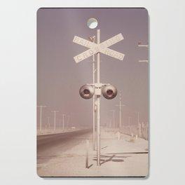 White dust on railroad crossing Cutting Board