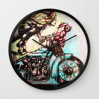 moto Wall Clocks featuring Moto D by Mo Baretta