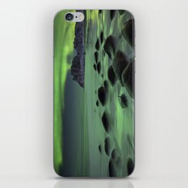 Aurora borealis over a beach on the Lofoten in Norway iPhone Skin