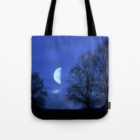 kindle Tote Bags featuring Moon between Trees  - JUSTART © by JUSTART