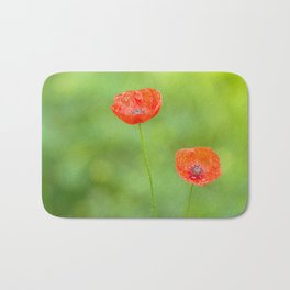 Two red poppies with water drops Bath Mat