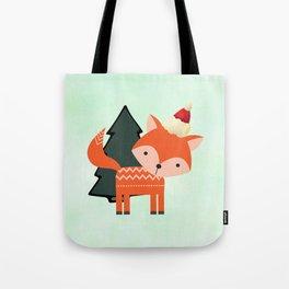 Orange Fox in Santa Hat in front of a Pine Tree Tote Bag