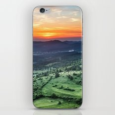 Beautiful sunset behind green fields iPhone & iPod Skin