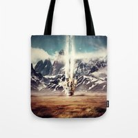 gravity Tote Bags featuring Gravity by James McKenzie