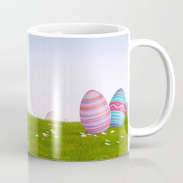 Decorated Easter eggs in a grassy hilly landscape Coffee Mug