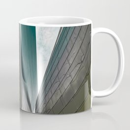 Architectural abstract of a metal clad building looming in symmetry and foreboding Coffee Mug