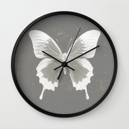 Butterfly on grunge surface Wall Clock