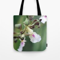 monkey island Tote Bags featuring Monkey Orchide by BACK to THE ROOTS