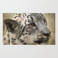 snow leopard Area & Throw Rugs featuring Snow Leopard by Jai Johnson