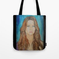 jennifer lawrence Tote Bags featuring Jennifer Lawrence by Jenn