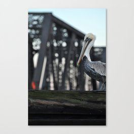 Lone Pelican perched aside the Old Ford Plant Bridge  Canvas Print