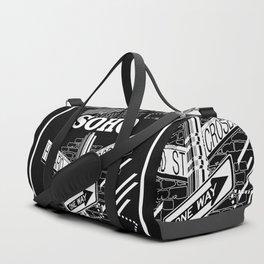 SoHo, New York Streets- white on black Duffle Bag