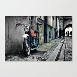 Small motorcycle parked Canvas Print