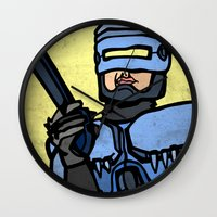 robocop Wall Clocks featuring RoboCop by Rat McDirtmouth