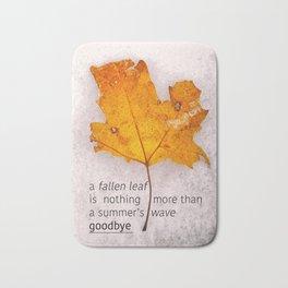Autumn. Fallen leaf on dirty ice. Bath Mat