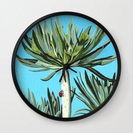Ladybug on exotic plant Wall Clock