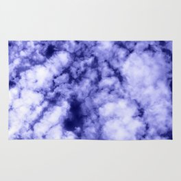 Clouds in a dark blue sky Rug