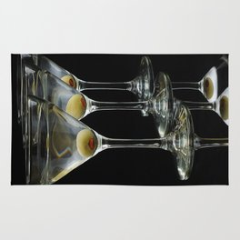 Three Martini's and three olives.  Rug