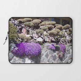 Rock Retaining Wall With Beautiful Trees and Purple Flowers Laptop Sleeve