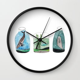 whales in a jar Wall Clock