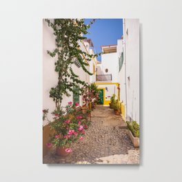 Charming cobblestone street in the whitewashed town of Tavira, Portugal Metal Print