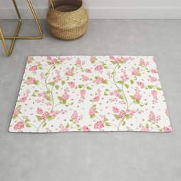 Pink Hydrangea Flower Blooms and Buttercup Flower Blooms on White Rug