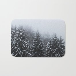 Fog over snow covered spruce forest in winter Bath Mat