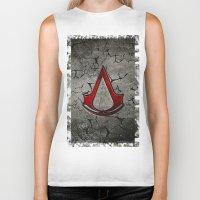 assassins creed Biker Tanks featuring Creed Assassins Logo by Andrian Kembara