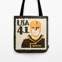 superheros Tote Bags featuring The Ray by Teighe Armour Thorsen