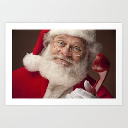 Santa Claus holding a red telephone Art Print