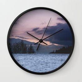 The colors of the sky during sunset with clouds in Austria. Wall Clock