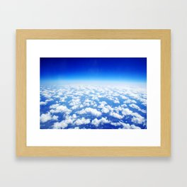 Looking Above the Clouds Framed Art Print