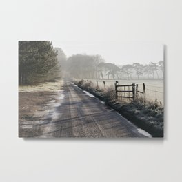 Remote frozen country road a t sunrise. Norfolk, UK. Metal Print