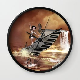 Cute girl dancing on a piano on the beach Wall Clock