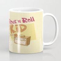 rock n roll Mugs featuring Rock n Roll Kid by Ariel Fajtlowicz