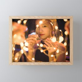 Woman Through String of Lights Framed Mini Art Print