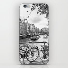 Bicycles parked on bridge over Amsterdam canal iPhone Skin