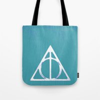 deathly hallows Tote Bags featuring Deathly Hallows - Blue by Phoenix Prints
