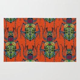 flower beetle orange Rug