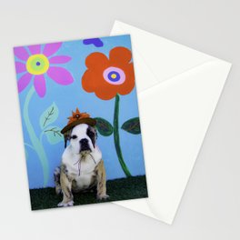 English Bulldog Puppy Wearing a Hat in front of a Spring Background with Tall Flowers Stationery Cards
