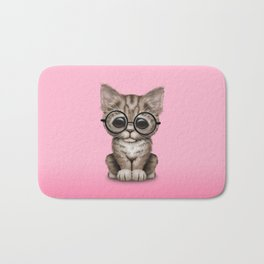 Cute Brown Tabby Kitten Wearing Eye Glasses on Pink Bath Mat
