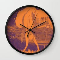 iron giant Wall Clocks featuring Giant by Aimee MaCray