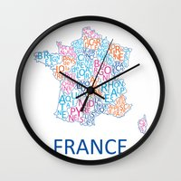 france Wall Clocks featuring France by Alexandra Dzh