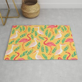 Pink flamingos, pelicans, tropical leaves on yellow background. Decorative seamless vector pattern. Rug