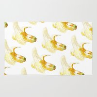 banana Area & Throw Rugs featuring Banana by Imanol Buisan