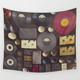Music. Vintage wall with vinyl records and audio cassettes hung. Wall Tapestry