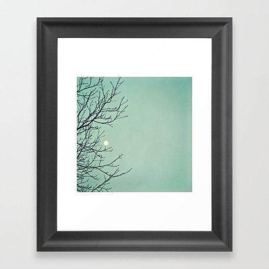 Holding the moon Framed Art Print