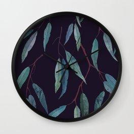 Eucalyptus leaves on deep blue Wall Clock