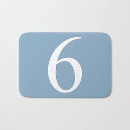 number six sign on placid blue color background Bath Mat